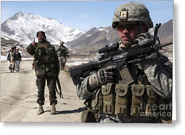 Foot Patrol Greeting Cards - U.s. Army Soldier Conducts A Patrol Greeting Card by Stocktrek Images
