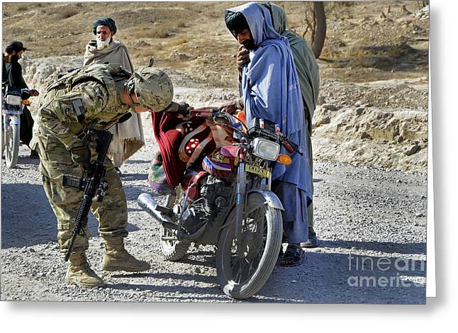 Cooperation Greeting Cards - U.s. Army Soldier Conducts Vehicle Greeting Card by Stocktrek Images