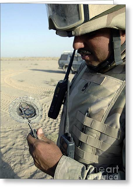 Fragmentation Greeting Cards - U.s. Army Soldier Examines Ballistic Greeting Card by Stocktrek Images