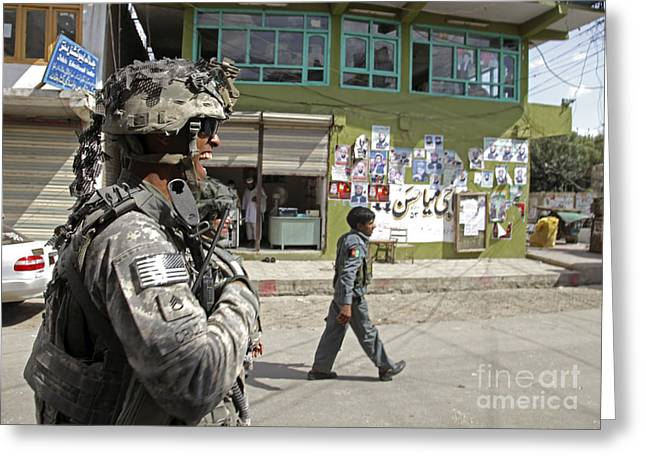 Us Open Photographs Greeting Cards - U.s. Army Soldier Patrolling Greeting Card by Stocktrek Images