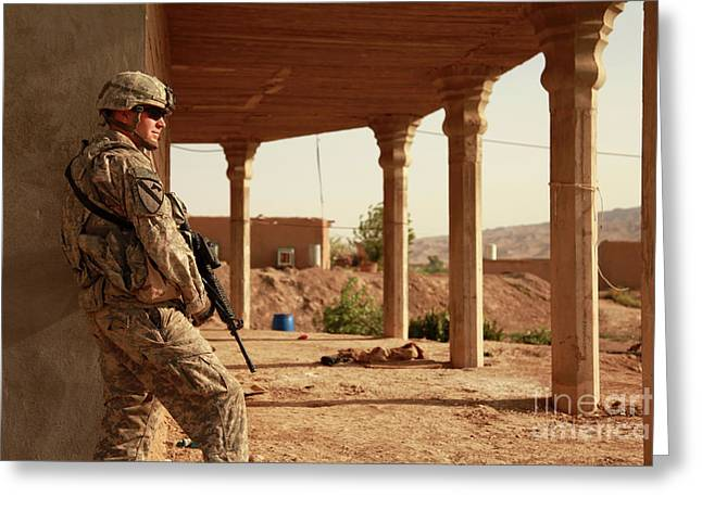 Iraq Photographs Greeting Cards - U.s. Army Soldier Pulls Security Greeting Card by Stocktrek Images