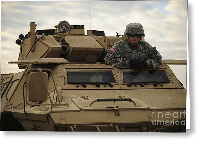 Law Enforcement Greeting Cards - U.s. Army Soldier Stands In The Drivers Greeting Card by Stocktrek Images