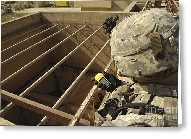 Iraq Greeting Cards - U.s. Army Soldier Takes A Gps Grid Greeting Card by Stocktrek Images