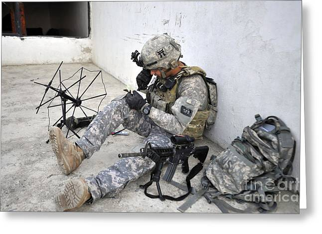 Prc-117 Greeting Cards - U.s. Army Soldier Tests The Radio Greeting Card by Stocktrek Images
