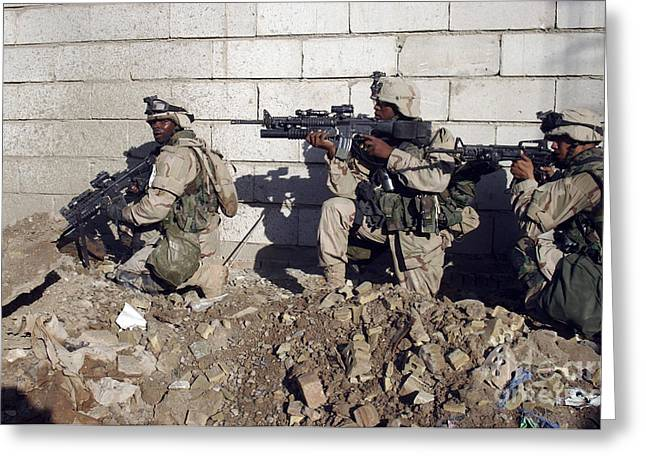 Operation Iraqi Freedom Greeting Cards - U.s. Army Soldiers Moving Along A Wall Greeting Card by Stocktrek Images