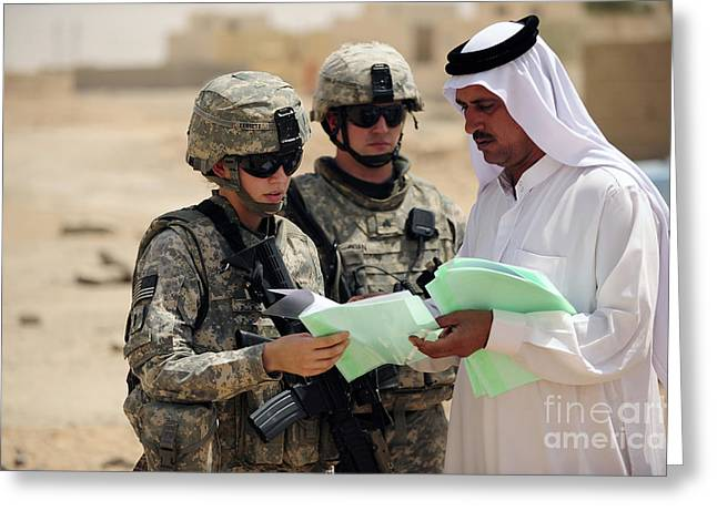 Cooperation Greeting Cards - U.s. Army Soldiers Talking With A Town Greeting Card by Stocktrek Images