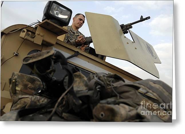 Hmmwv Greeting Cards - U.s. Army Specialist Prepares Greeting Card by Stocktrek Images