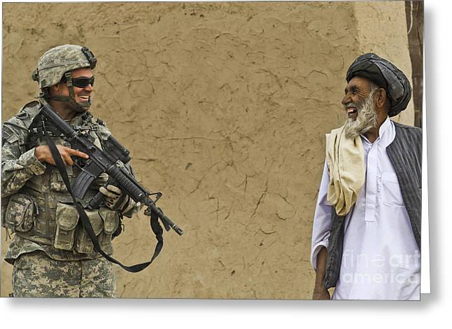 Zabul Greeting Cards - U.s. Army Specialist Talks To An Afghan Greeting Card by Stocktrek Images