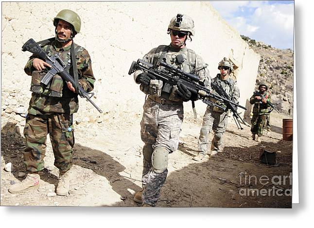 Foot Patrol Greeting Cards - U.s. Army Troops Lead A Patrol Greeting Card by Stocktrek Images