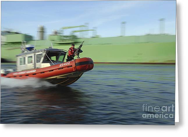 Law Enforcement Greeting Cards - U.s. Coast Guard Officer Mans A M240b Greeting Card by Stocktrek Images