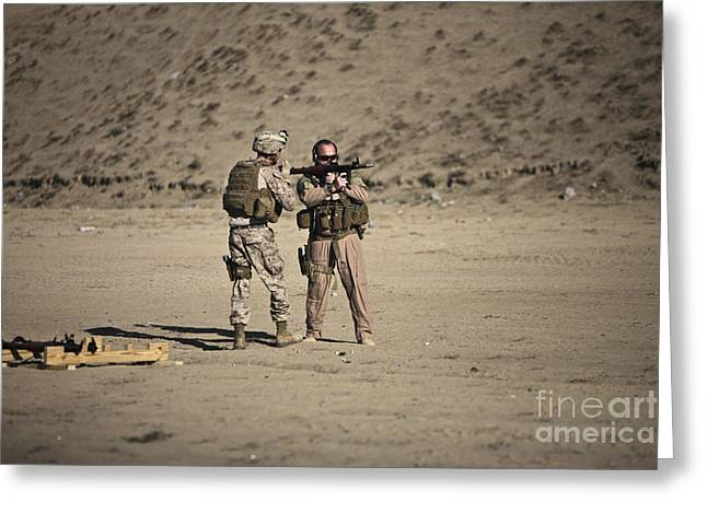 Fragmentation Greeting Cards - U.s. Contractor Firing An Automatic Greeting Card by Terry Moore