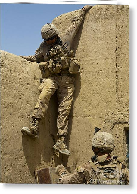 Sangin Greeting Cards - U.s. Marine Climbs Down From An Greeting Card by Stocktrek Images