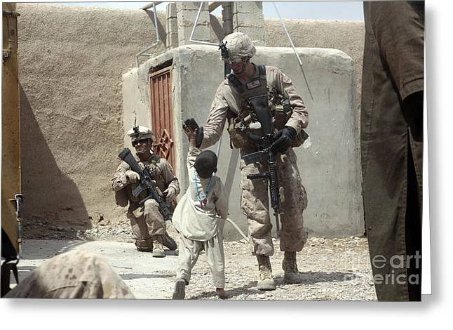 U.s. Marine Gives An Afghan Child Greeting Card by Stocktrek Images