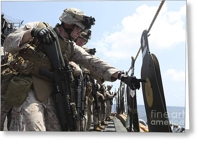 Deployment Greeting Cards - U.s. Marine Looks Over His Target Greeting Card by Stocktrek Images