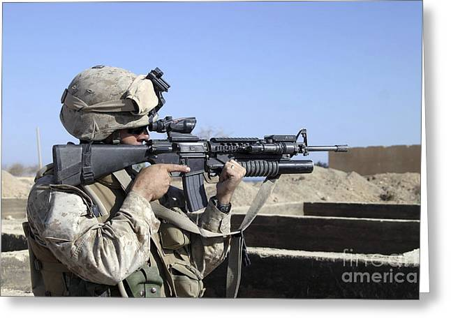 40mm Greeting Cards - U.s. Marine Sites Through The Scope Greeting Card by Stocktrek Images