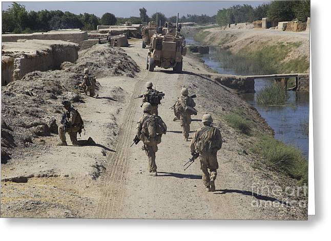 Foot Patrol Greeting Cards - U.s. Marines Conduct A Security Patrol Greeting Card by Stocktrek Images