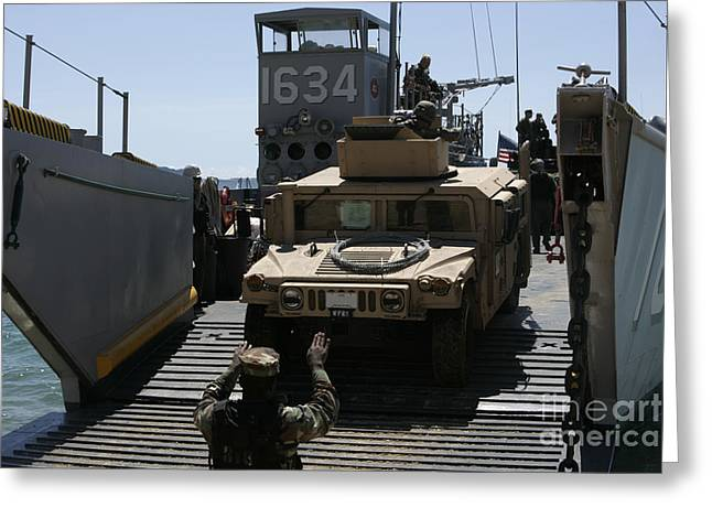 M1114 Greeting Cards - U.s. Marines Load An M1114 Humvee Onto Greeting Card by Stocktrek Images