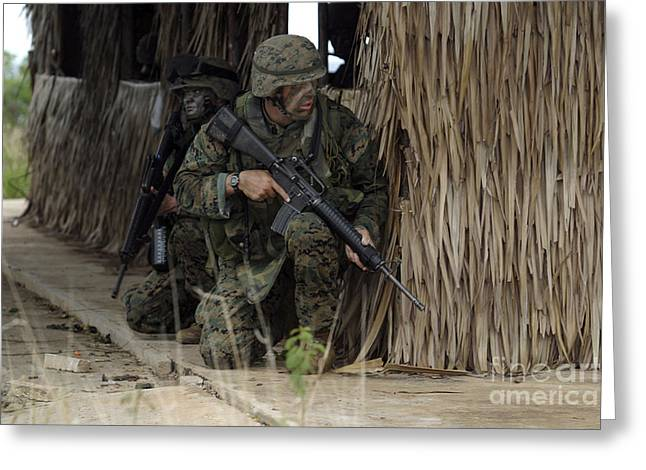 Bamboo House Photographs Greeting Cards - U.s. Marines Prepare To Enter A House Greeting Card by Stocktrek Images