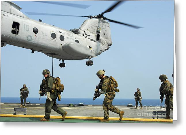 Fast-roping Greeting Cards - U.s. Marines Run Across The Deck Greeting Card by Stocktrek Images