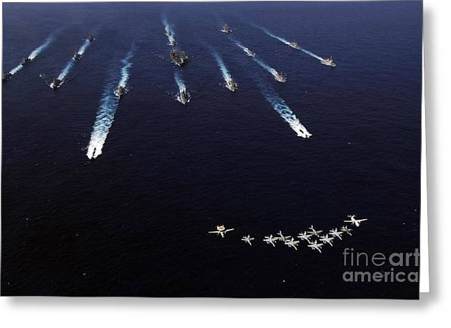 Strike Group Greeting Cards - U.s. Navy Aircraft Fly Over A Formation Greeting Card by Stocktrek Images