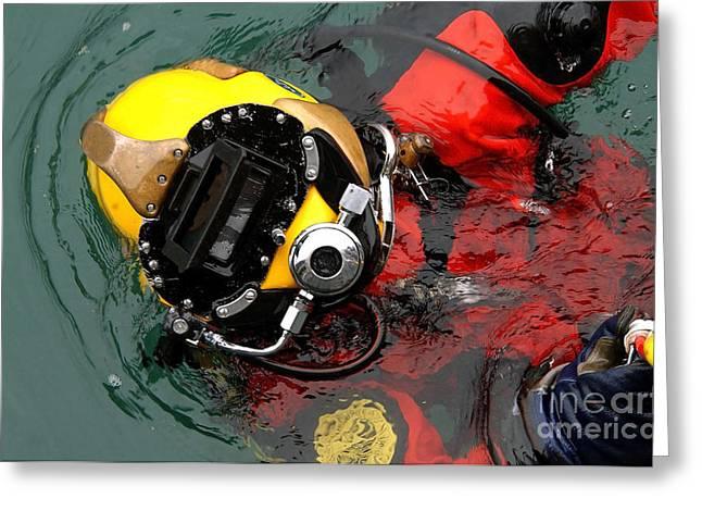 Diving Helmet Greeting Cards - U.s. Navy Diver Is Lowered Greeting Card by Stocktrek Images