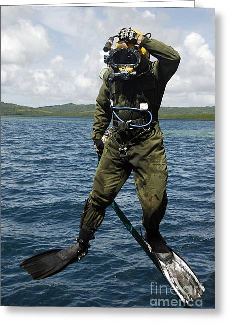 Scuba Diving Greeting Cards - U.s. Navy Diver Jumps Off A Dive Greeting Card by Stocktrek Images