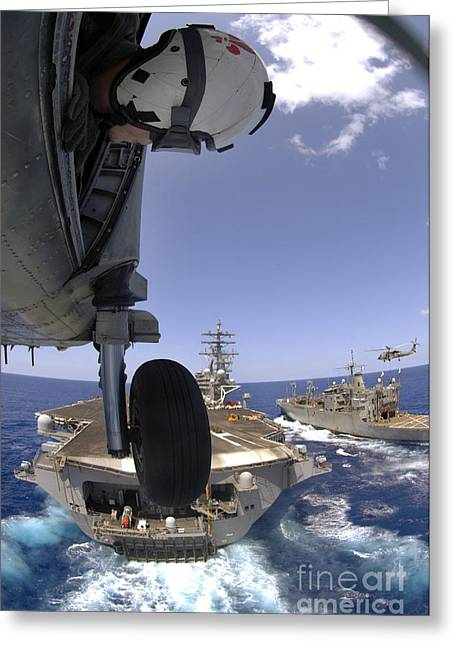 Rotary Wing Aircraft Photographs Greeting Cards - U.s. Navy Petty Officer Leans Greeting Card by Stocktrek Images