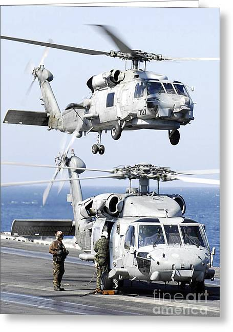 Aircrew Greeting Cards - U.s. Navy Seahawk Helicopter Lifting Greeting Card by Stocktrek Images