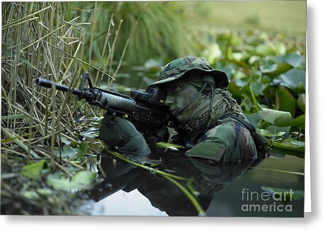 U.s. Navy Seal Crosses Through A Stream Greeting Card by Tom Weber