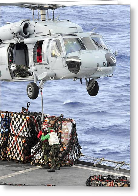 Hovering Greeting Cards - U.s. Sailors Connect A Cargo Pendant Greeting Card by Stocktrek Images