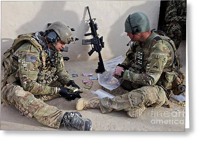Scrutiny Greeting Cards - U.s. Soldiers Count Money Found While Greeting Card by Stocktrek Images