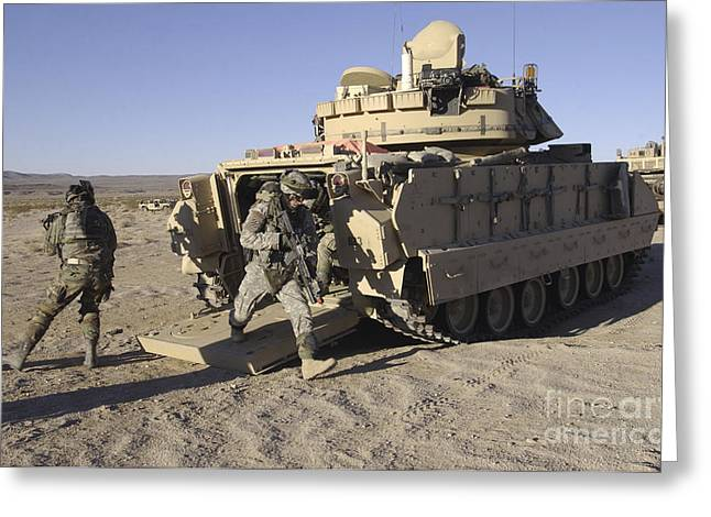 Us Army Tank Greeting Cards - U.s. Soldiers Exit From An M2 Bradley Greeting Card by Stocktrek Images