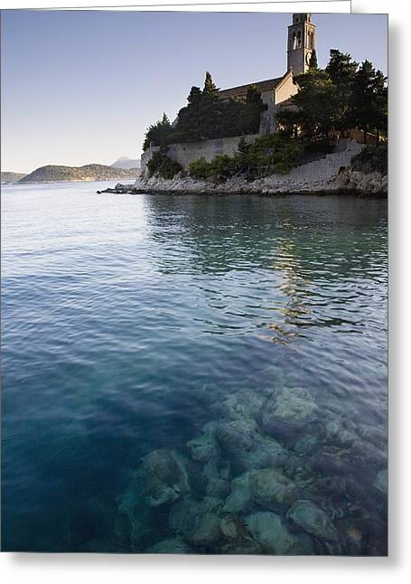 Historical Buildings Greeting Cards - View Across Water At A Monastery On The Greeting Card by Axiom Photographic