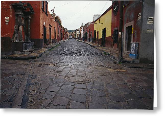 Art Of Building Greeting Cards - View Of Cobblestone Streets In San Greeting Card by Gina Martin