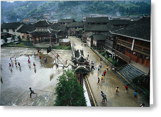 Chinese Ethnicity Greeting Cards - Village Children Play In The Wet School Greeting Card by Lynn Johnson