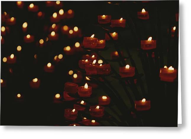 Light And Dark Greeting Cards - Votive Candles In Notre Dame Cathedral Greeting Card by Raul Touzon