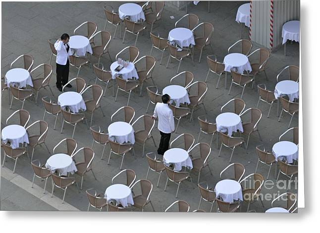 Sami Sarkis Greeting Cards - Waiters at empty cafe terrace on Piazza San Marco Greeting Card by Sami Sarkis
