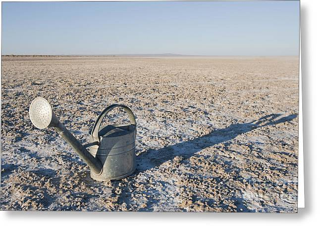 Casting A Shadow Greeting Cards - Water Pail on Dried Mud Greeting Card by Thom Gourley/Flatbread Images, LLC