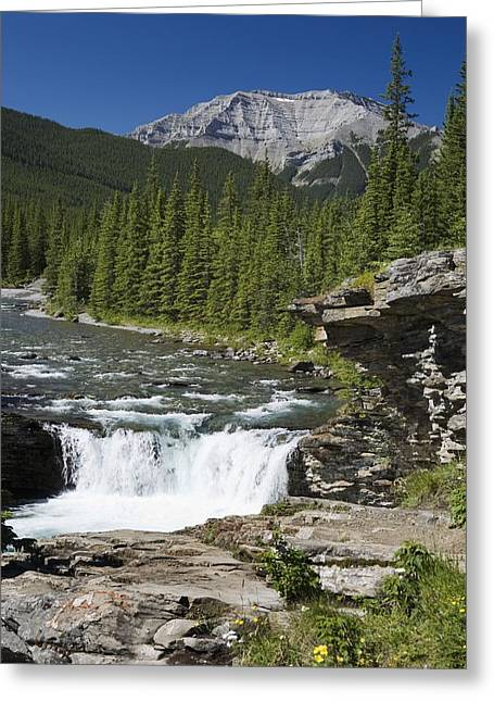 Ledge Photographs Greeting Cards - Waterfalls With Rock Ledge And Mountain Greeting Card by Michael Interisano