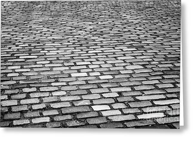 wet cobblestoned huntly street in the union street area of aberdeen scotland uk Greeting Card by Joe Fox
