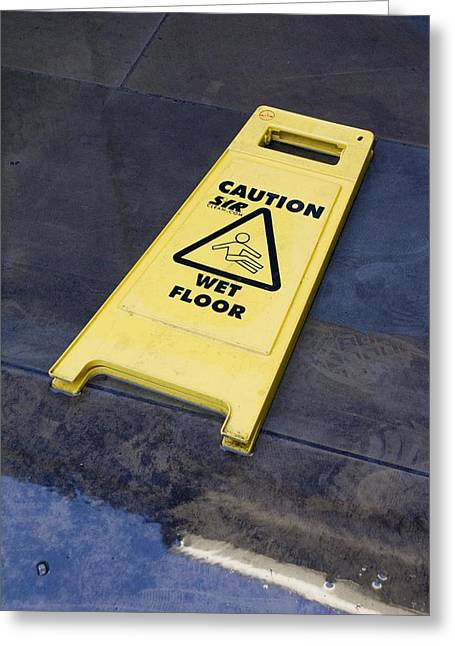 Wet Floor Greeting Cards - Wet Floor Sign In Puddle Greeting Card by Mark Williamson