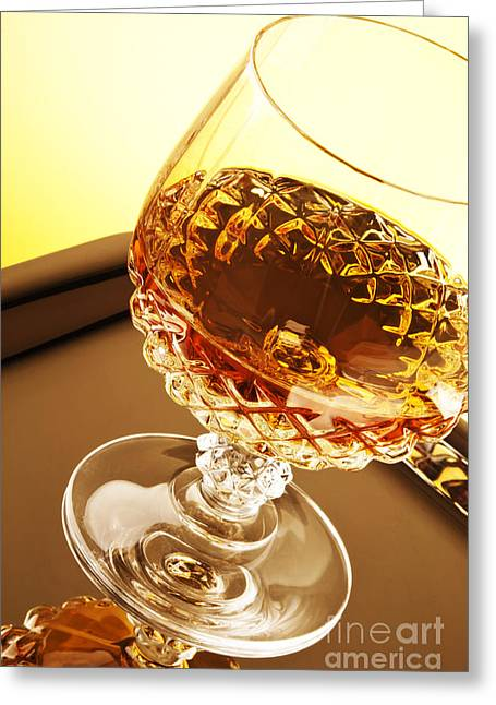 Goblet Greeting Cards - Whiskey in glass Greeting Card by Blink Images