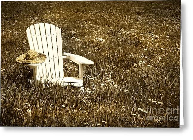 Grow Digital Art Greeting Cards - White chair with straw hat in a field Greeting Card by Sandra Cunningham