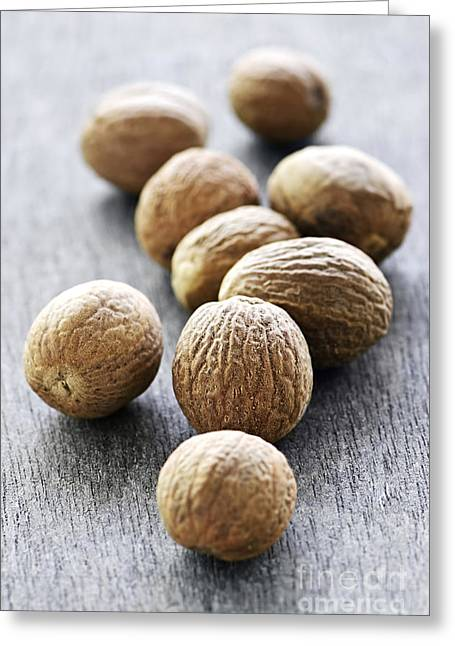 Loose Greeting Cards - Whole nutmeg seeds Greeting Card by Elena Elisseeva