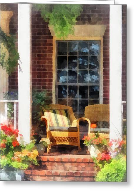 Suburban Greeting Cards - Wicker Chair With Striped Pillow Greeting Card by Susan Savad
