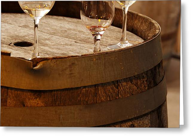 Wine glasses on an old wine barrel  Greeting Card by Michael Gray