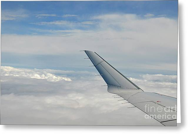 Getting Air Greeting Cards - Wings of flying airplane over clouds Greeting Card by Sami Sarkis