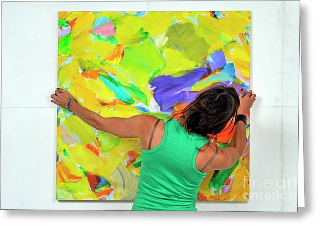 Product Photographs Greeting Cards - Woman adjusting a painting Greeting Card by Sami Sarkis