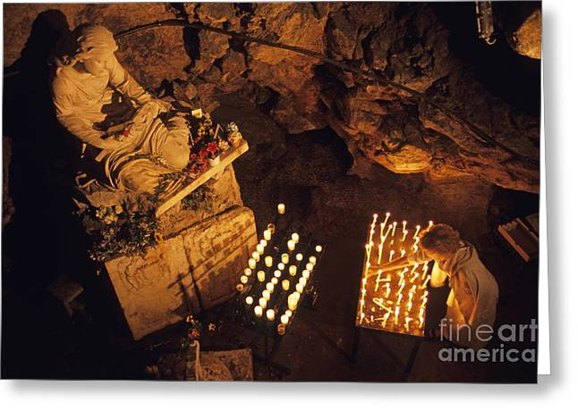 Burning Statue Greeting Cards - Woman burning candle at Troglodyte Sainte-Marie Madeleine Holy Cave Greeting Card by Sami Sarkis