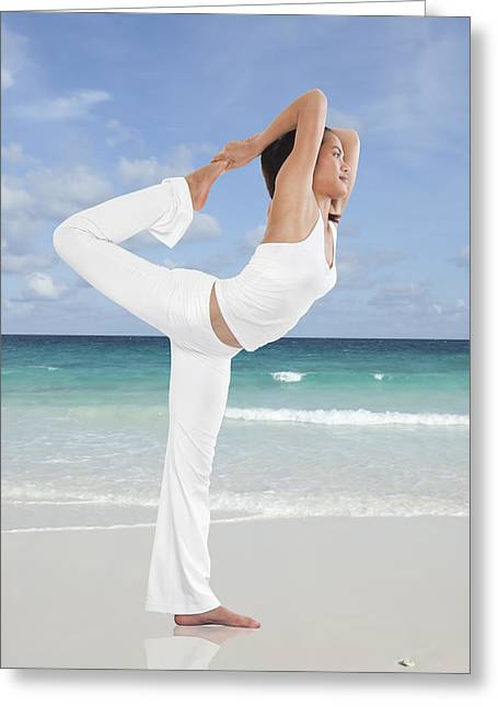 Concentration Greeting Cards - Woman doing yoga on the beach Greeting Card by Setsiri Silapasuwanchai